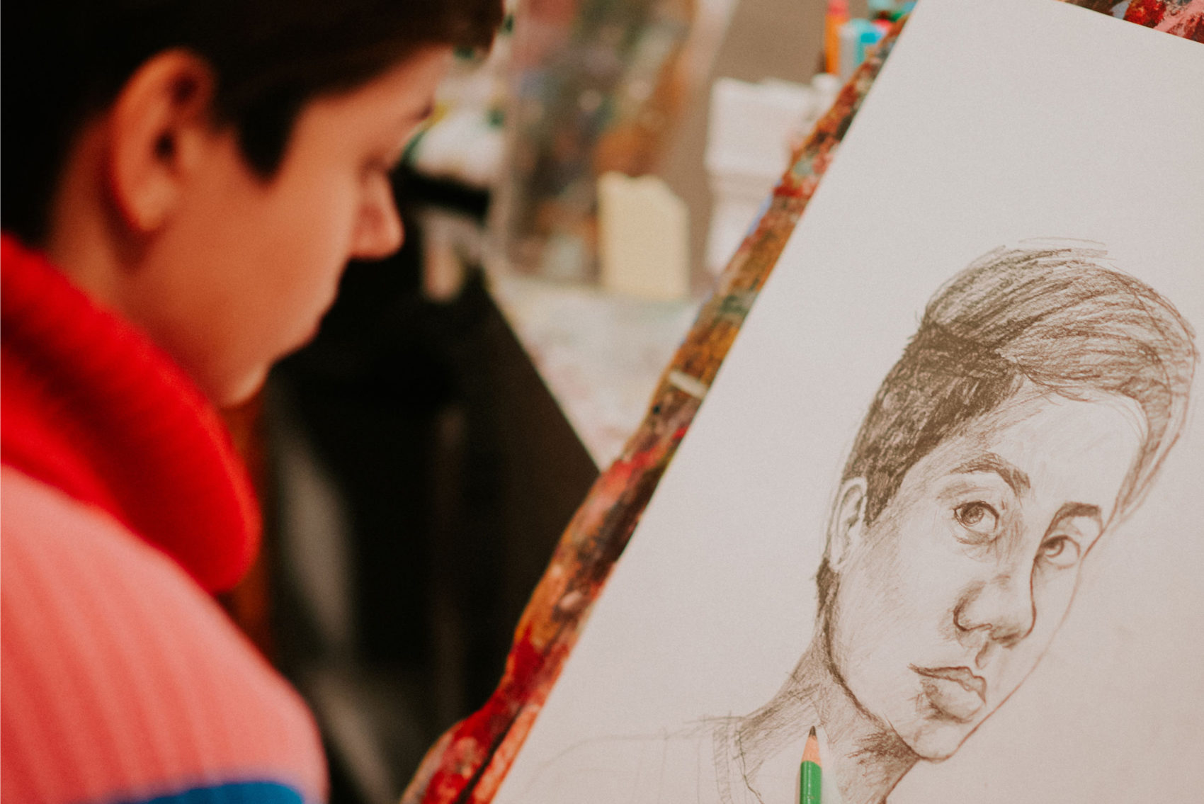 Student with self portrait