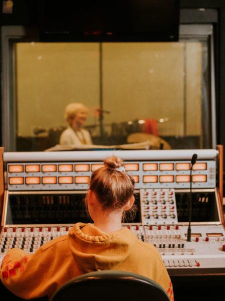 Student in sound studio.