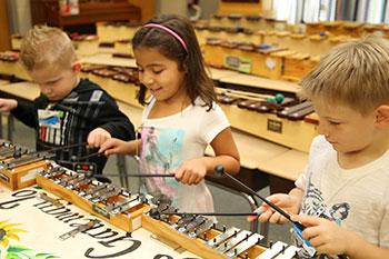 Children playing xylophones.