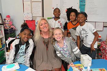 Children crowd around their teacher for a picture at Ruth N. Upson Elementary School in Jacksonville, FL