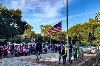 Flag raising ceremony at Joseph Finegan Elementary School