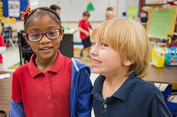 Students smile at Joseph Finegan Elementary School.