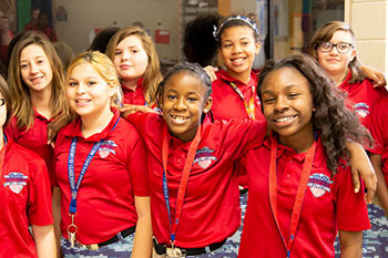 Students stand together smiling at Joseph Stilwell Middle School in Jacksonville, FL.