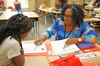 Mandarin Oaks Elementary School teacher assists a student.