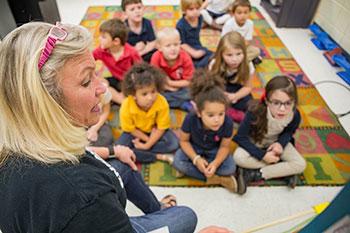 A teacher reads a book to her class at Finegan Elementary School in Atlantic Beach, FL