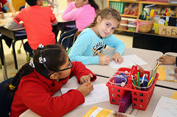 Students learning in a classroom.
