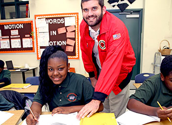 City Year tutor with a Matthew Gilbert Middle School student
