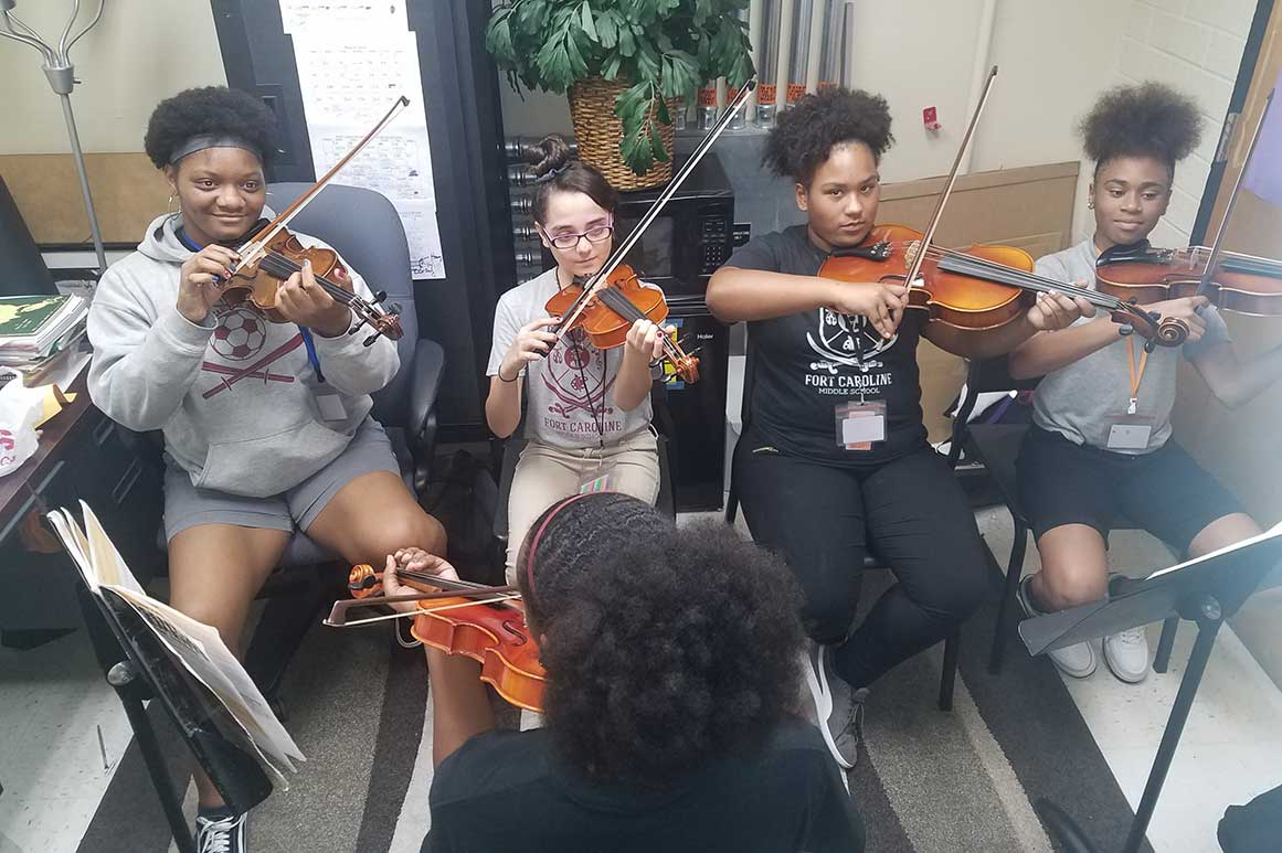Violin lessons at Fort Caroline Middle School for the Arts