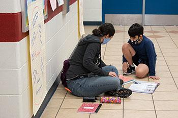 Teacher at Bartram Springs assisting student