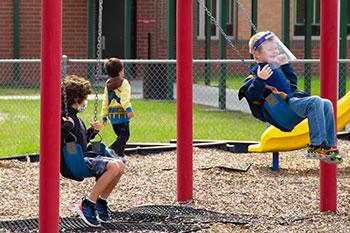 Students on swings at Bartram Springs Elementary School